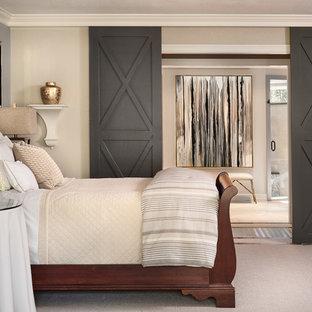 Bedroom - transitional carpeted bedroom idea in Denver with beige walls