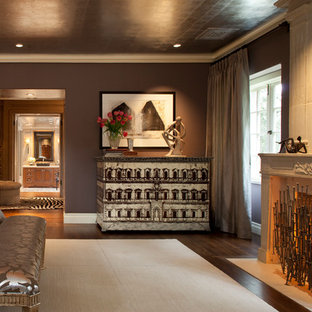 Inspiration for a transitional dark wood floor bedroom remodel in San Francisco with brown walls and a standard fireplace