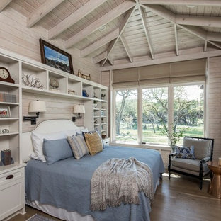 Inspiration for a transitional master medium tone wood floor bedroom remodel in Other