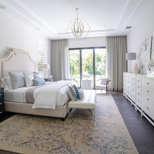 Bedroom - transitional dark wood floor and brown floor bedroom idea in Miami with white walls