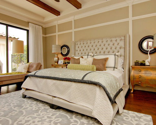 Example Of A Transitional Dark Wood Floor Bedroom Design In Orlando With Beige Walls