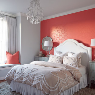 This is an example of a transitional master bedroom in Nashville with pink walls.