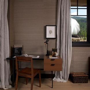 Example of a transitional light wood floor bedroom design in Denver with gray walls