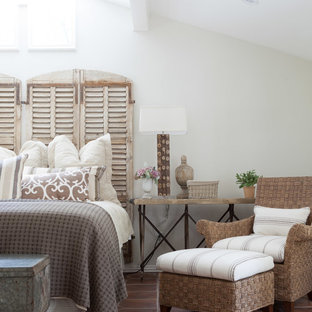 This is an example of a transitional bedroom in Dallas with terra-cotta floors.