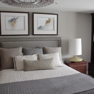 This is an example of a mid-sized transitional master bedroom in Other with grey walls, carpet and beige floor.