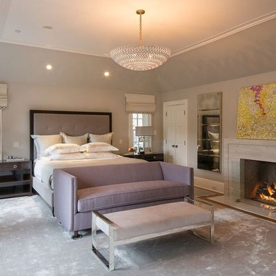 Inspiration for a large transitional master carpeted and gray floor bedroom remodel in New York with gray walls, a standard fireplace and a stone fireplace