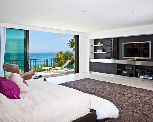 Large Trendy Master Light Wood Floor And Beige Floor Bedroom Photo In Los  Angeles With White