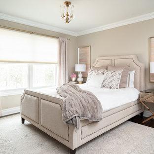Example of a transitional dark wood floor and brown floor bedroom design in New York with beige walls