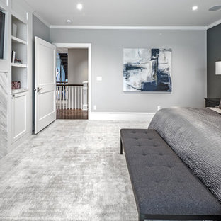 Inspiration for a large transitional master carpeted and gray floor bedroom remodel in Seattle with gray walls, a standard fireplace and a stone fireplace
