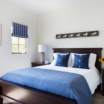 Mid-sized transitional master carpeted and beige floor bedroom photo in Los Angeles with white walls