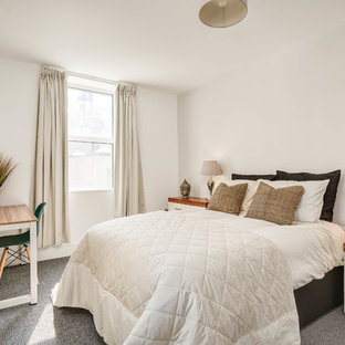 Photo of a medium sized contemporary bedroom in Devon with white walls, carpet and grey floors.