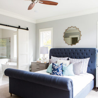 Photo of a large transitional master bedroom in Salt Lake City with grey walls, carpet and no fireplace.