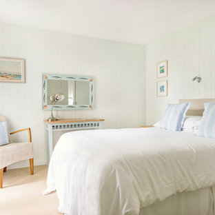 Photo of a small coastal bedroom in Cornwall with green walls, carpet and beige floors.