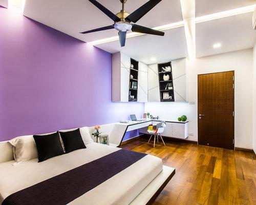 Camera da letto moderna con pareti viola foto idee - Pareti camera da letto viola ...