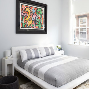 Minimalist bedroom photo in Other with gray walls