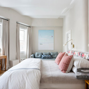 Inspiration for a timeless master light wood floor bedroom remodel in New York with beige walls