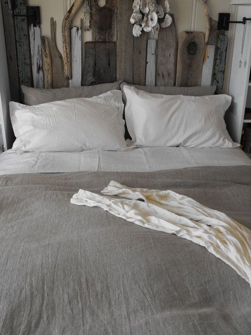 inspiration for a beach style bedroom remodel in san francisco with beige walls