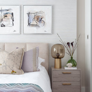 Inspiration for a contemporary bedroom in London with beige walls, dark hardwood flooring and brown floors.