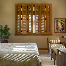 Tropical Bedroom by Gilleland Interior Design