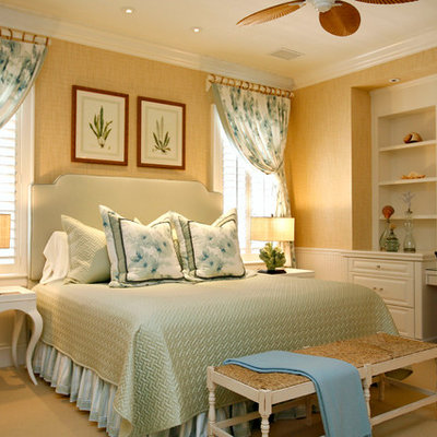 Inspiration for a tropical carpeted bedroom remodel in Other with beige walls