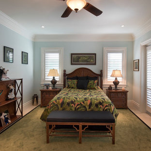 Bedroom - tropical guest carpeted and beige floor bedroom idea in Miami with blue walls