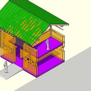 Imagen de habitación de invitados exótica, pequeña, con paredes amarillas y suelo de baldosas de terracota