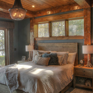 Example of a mid-sized mountain style guest medium tone wood floor and brown floor bedroom design in Minneapolis with gray walls