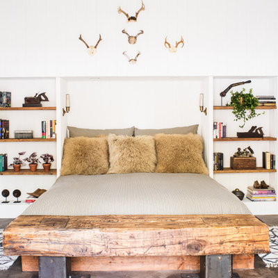 Inspiration for a rustic bedroom remodel in San Francisco with white walls