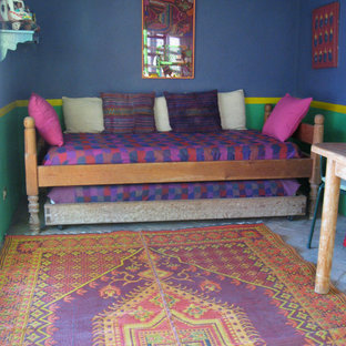 Example of an eclectic guest brick floor bedroom design in Other with blue walls