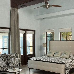 Design ideas for a mediterranean bedroom in Other with grey walls.