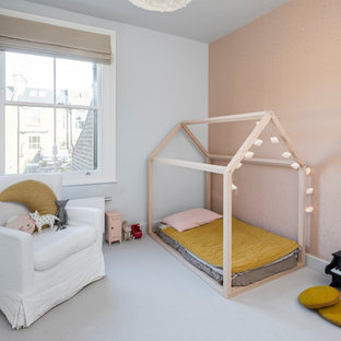 Photo of a large scandinavian guest bedroom in London with carpet, grey floor, grey walls and wallpaper.