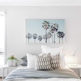 Contemporary bedroom in Melbourne with beige walls, carpet and beige floor.