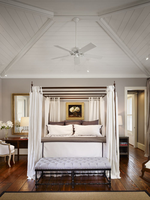 Example Of A Large Country Master Dark Wood Floor Bedroom Design In Houston  With Gray Walls