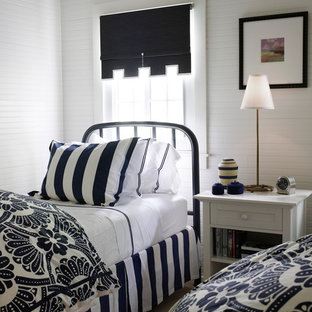 Bedroom - beach style guest bedroom idea in Chicago with white walls