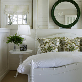 Example of a beach style carpeted bedroom design in Chicago with white walls