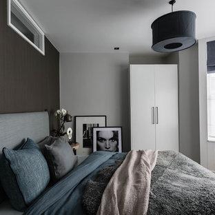 Inspiration for a medium sized scandinavian master bedroom in London with grey walls, light hardwood flooring and beige floors.