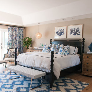 This is an example of a medium sized classic master bedroom in Orange County with beige walls, dark hardwood flooring, no fireplace and brown floors.