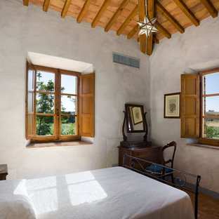 Example of a tuscan bedroom design in New York with gray walls