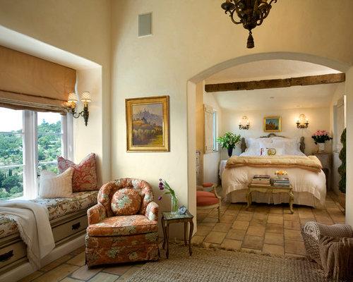 Example of a tuscan brown floor bedroom design in Santa Barbara with beige  walls. Bedroom Floor Tiles   Houzz