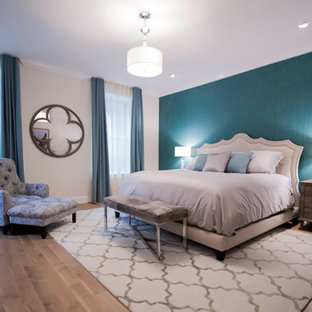 Transitional master bedroom photo in New York with beige walls
