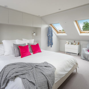 Design ideas for a medium sized contemporary bedroom in London with grey walls, carpet and grey floors.