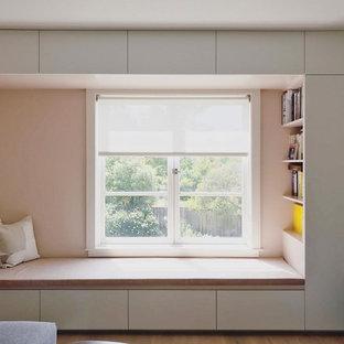 Bedroom - contemporary light wood floor and brown floor bedroom idea in San Francisco with pink walls