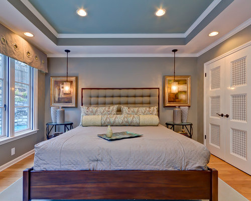 Example of a transitional bedroom design in Nashville with gray walls