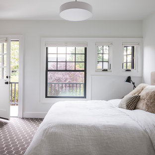 Photo of a large transitional master bedroom in Seattle with white walls, carpet, no fireplace and multi-coloured floor.