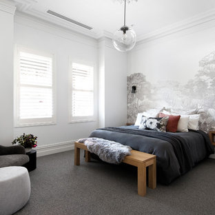 Design ideas for a contemporary bedroom in Melbourne with white walls, carpet and grey floor.