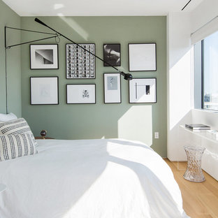 Bedroom - mid-sized contemporary guest light wood floor bedroom idea in New York with green walls and no fireplace
