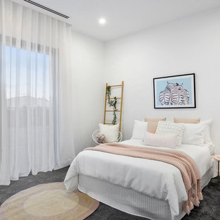 Inspiration for a contemporary guest bedroom in Geelong with white walls, carpet and grey floor.