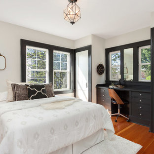 Example of a large transitional master medium tone wood floor and orange floor bedroom design in Seattle with no fireplace and white walls