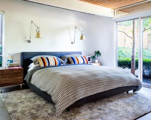 Example Of A Mid Sized Midcentury Modern Concrete Floor Bedroom Design In  Portland