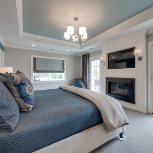Mid-sized transitional master carpeted and gray floor bedroom photo in Philadelphia with gray walls, a standard fireplace and a wood fireplace surround